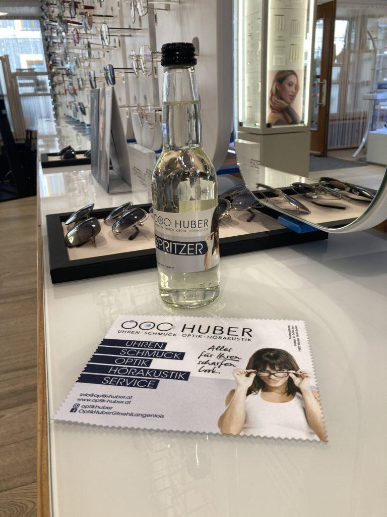 Spritzer 0,33l mit personalisierten Etiketten für Optik Huber